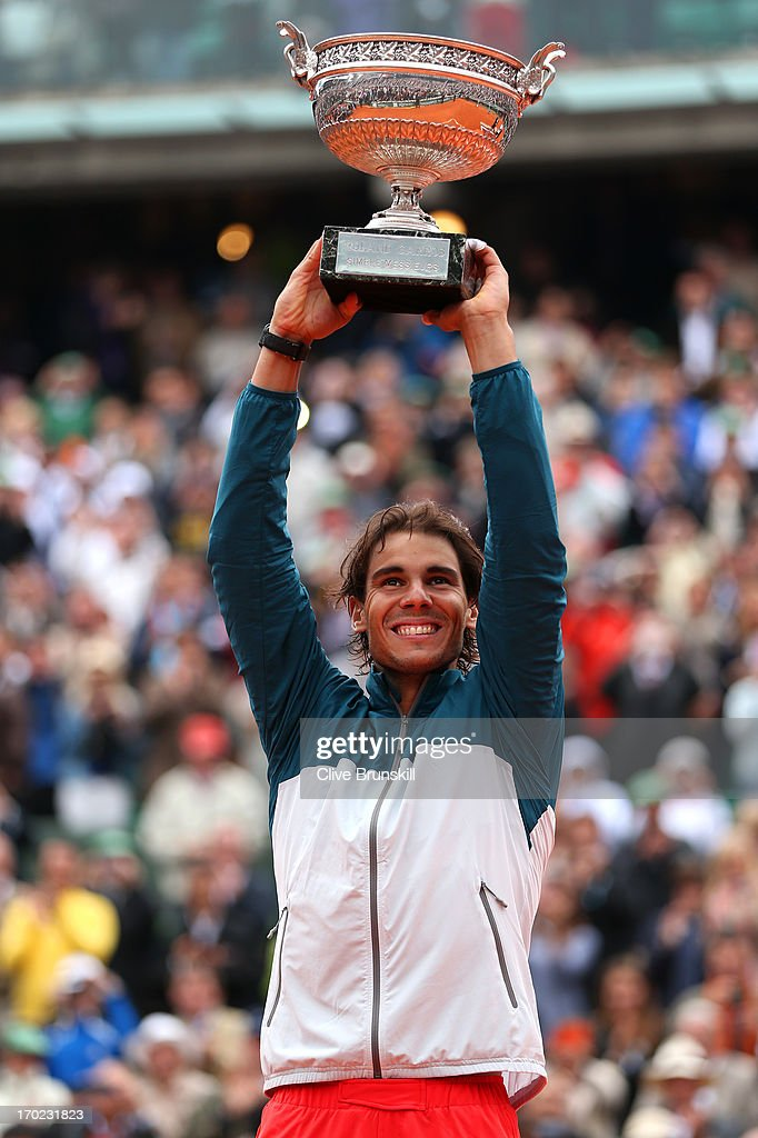 <a gi-track='captionPersonalityLinkClicked' href=/galleries/search?phrase=Rafael+Nadal&family=editorial&specificpeople=194996 ng-click='$event.stopPropagation()'>Rafael Nadal</a> of Spain celebrates victory with the Coupe des Mousquetaires trophy in the men's singles final against David Ferrer of Spain during day fifteen of the French Open at Roland Garros on June 9, 2013 in Paris, France.
