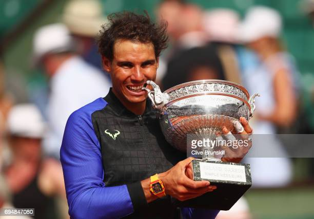 Rafael Nadal of Spain celebrates victory with the trophy after the men's singles final against Stan Wawrinka of Switzerland on day fifteen of the...