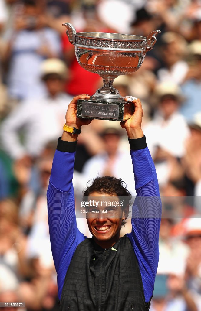 Rafael Nadal of Spain celebrates victory with the trophy following the mens singles final against Stan Wawrinka of Switzerland on day fifteen of the 2017 French Open at Roland Garros on June 11, 2017 in Paris, France.