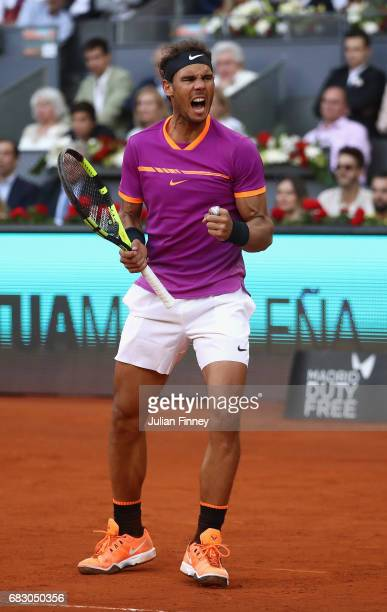 Rafael Nadal of Spain celebrates winning a game against Dominic Thiem of Austria in the final during day nine of the Mutua Madrid Open tennis at La...