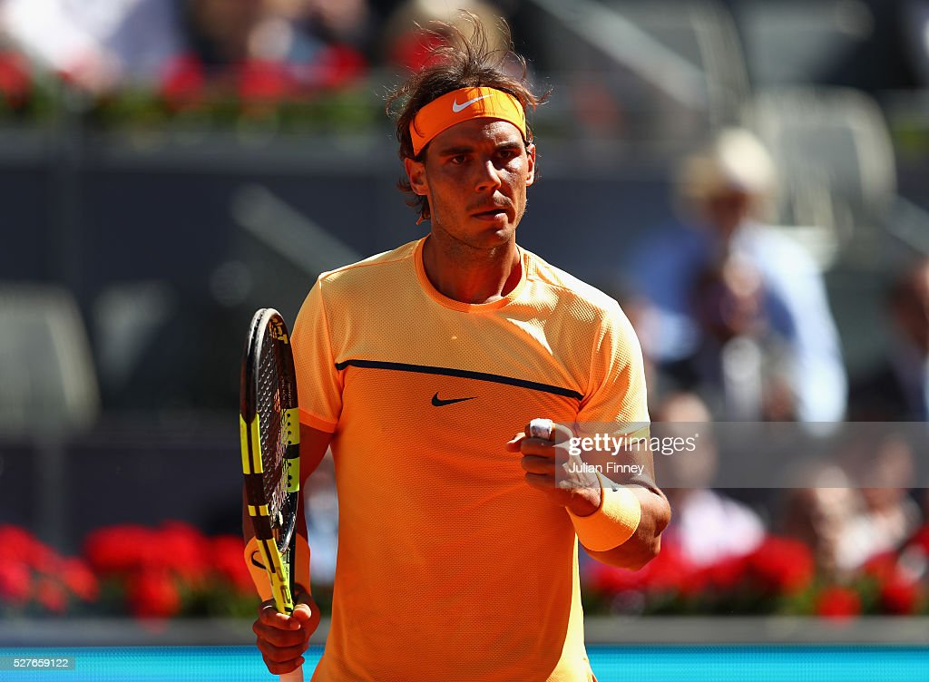 Rafael Nadal of Spain celebrates winning a point against Andrey Kuznetsov of Russia during day four of the Mutua Madrid Open tennis tournament at the Caja Magica on May 03, 2016 in Madrid, Spain.
