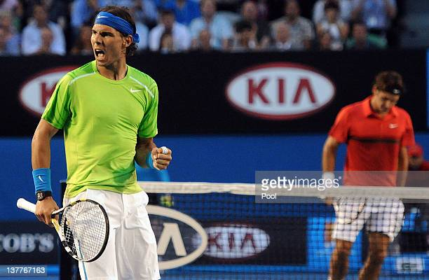 Rafael Nadal of Spain celebrates winning a point in his semifinal match against Roger Federer of Switzerland during day eleven of the 2012 Australian...
