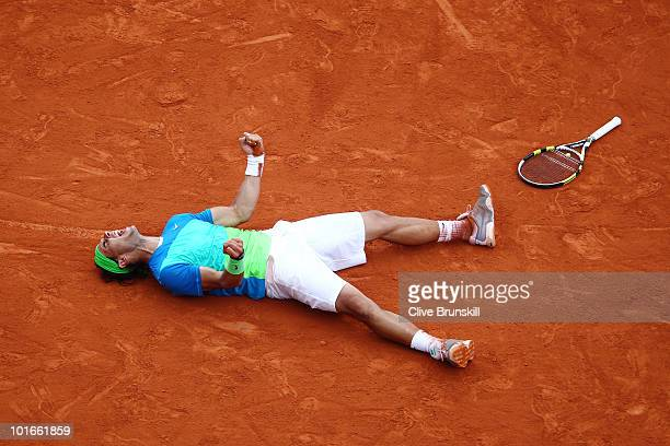 Rafael Nadal of Spain celebrates winning championship point during the men's singles final match between Rafael Nadal of Spain and Robin Soderling of...