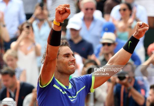 Rafael Nadal of Spain celebrates winning his 10th title at the French Open following the men's final on day 15 of the 2017 French Open second Grand...