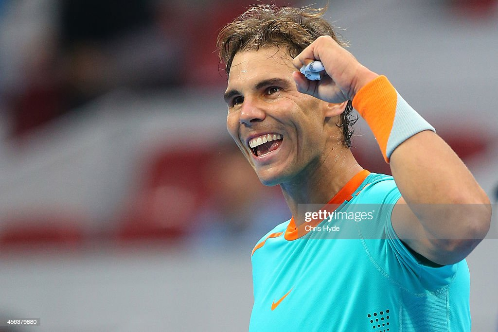 <a gi-track='captionPersonalityLinkClicked' href=/galleries/search?phrase=Rafael+Nadal&family=editorial&specificpeople=194996 ng-click='$event.stopPropagation()'>Rafael Nadal</a> of Spain celebrates winning his match against Richard Gasquet of France during day four of of the China Open at the National Tennis Center on September 30, 2014 in Beijing, China.