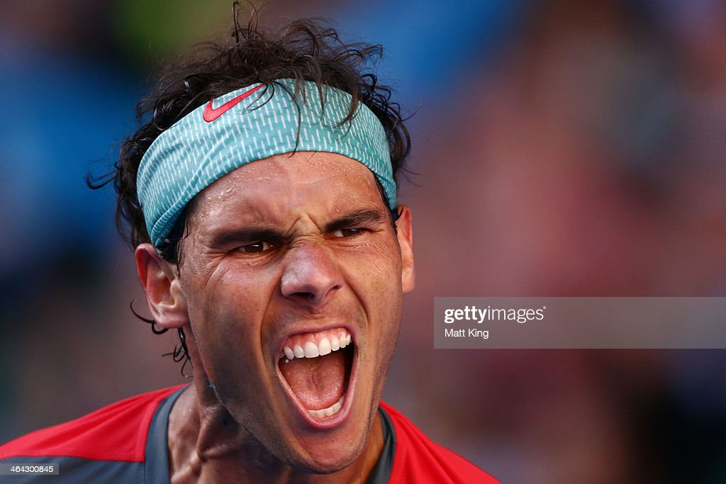 <a gi-track='captionPersonalityLinkClicked' href=/galleries/search?phrase=Rafael+Nadal&family=editorial&specificpeople=194996 ng-click='$event.stopPropagation()'>Rafael Nadal</a> of Spain celebrates winning his quarterfinal match against Grigor Dimitrov of Bulgaria during day 10 of the 2014 Australian Open at Melbourne Park on January 22, 2014 in Melbourne, Australia.