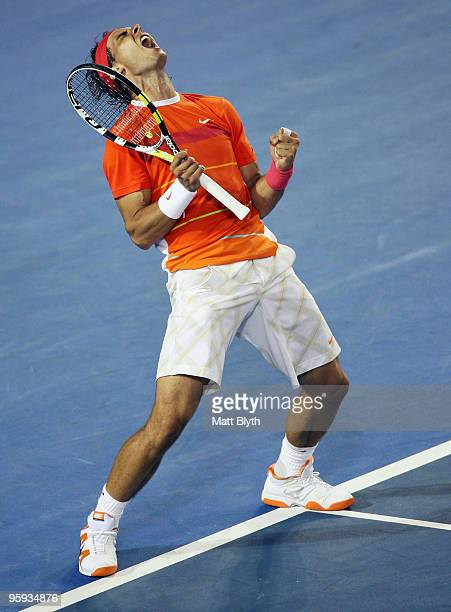 Rafael Nadal of Spain celebrates winning match point in his third round match against Philipp Kohlschreiber of Germany during day five of the 2010...