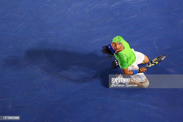 Rafael Nadal of Spain celebrates winning set point in his men's final match against Novak Djokovic of Serbia during day fourteen of the 2012...