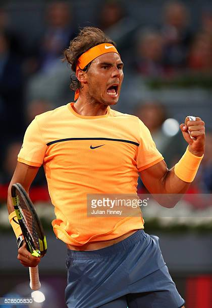 Rafael Nadal of Spain celebrates winning the first set against Sam Querrey of USA during day six of the Mutua Madrid Open tennis tournament at the...