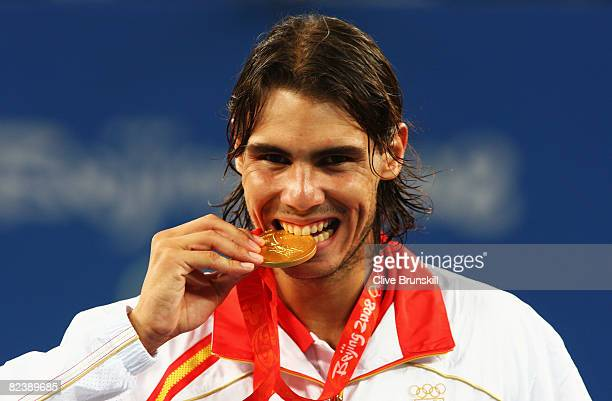 Rafael Nadal of Spain celebrates winning the gold medal against Fernando Gonzalez of Chile during the men's singles gold medal tennis match held at...
