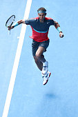 Rafael Nadal of Spain celebrates winning the second set in his fourth round match against Kei Nishikori of Japan during day eight of the 2014...