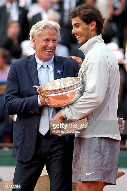Rafael Nadal of Spain celebrates with Bjorn Borg during his men's singles final match against Novak Djokovic of Serbia on day fifteen of the French...