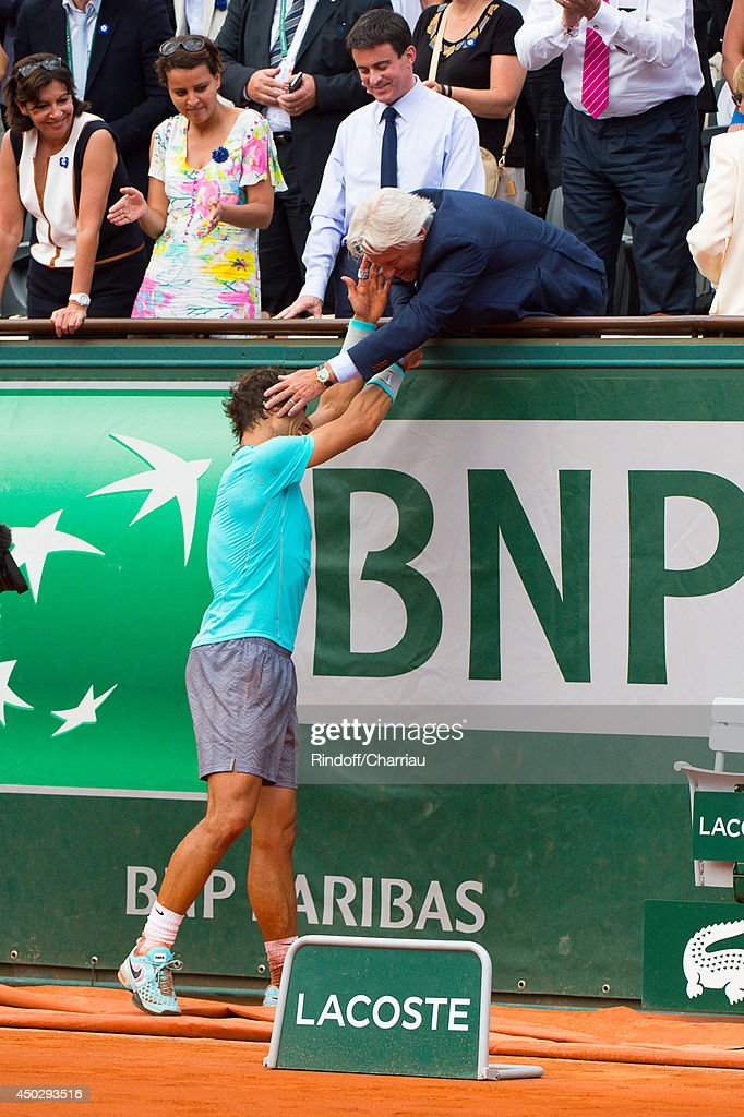 <a gi-track='captionPersonalityLinkClicked' href=/galleries/search?phrase=Rafael+Nadal&family=editorial&specificpeople=194996 ng-click='$event.stopPropagation()'>Rafael Nadal</a> of Spain celebrates with <a gi-track='captionPersonalityLinkClicked' href=/galleries/search?phrase=Bjorn+Borg+-+Tennis+Player&family=editorial&specificpeople=13488705 ng-click='$event.stopPropagation()'>Bjorn Borg</a> of Spain after his men's singles final match against Novak Djokovic of Serbia on day fifteen of the French Open at Roland Garros on June 8, 2014 in Paris, France.