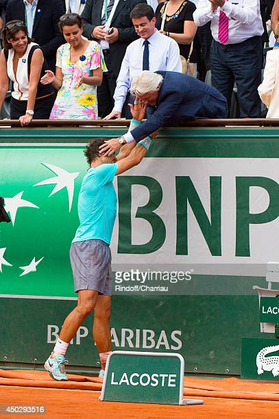 Rafael Nadal of Spain celebrates with Bjorn Borg of Spain after his men's singles final match against Novak Djokovic of Serbia on day fifteen of the...