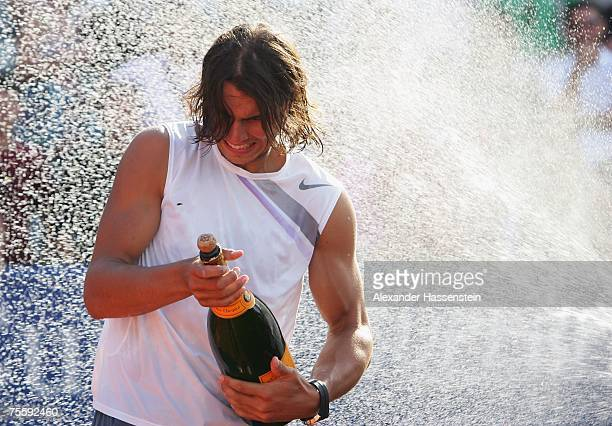 Rafael Nadal of Spain celebrates with champagne after winning the Mens final against Stanislas Wawrinka of Switzerland at the MercedesCup at TC...