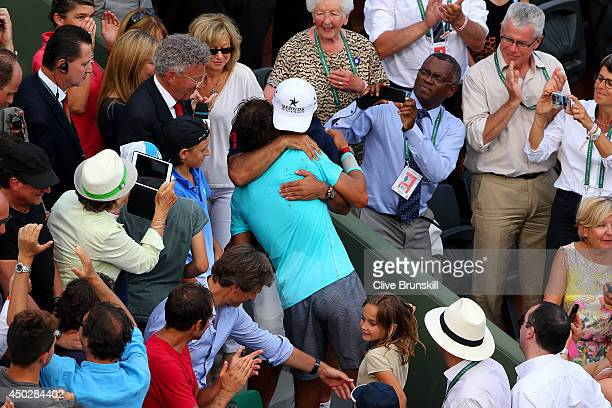 Rafael Nadal of Spain celebrates with his coach and uncle Toni Nadal after his men's singles final match against Novak Djokovic of Serbia on day...