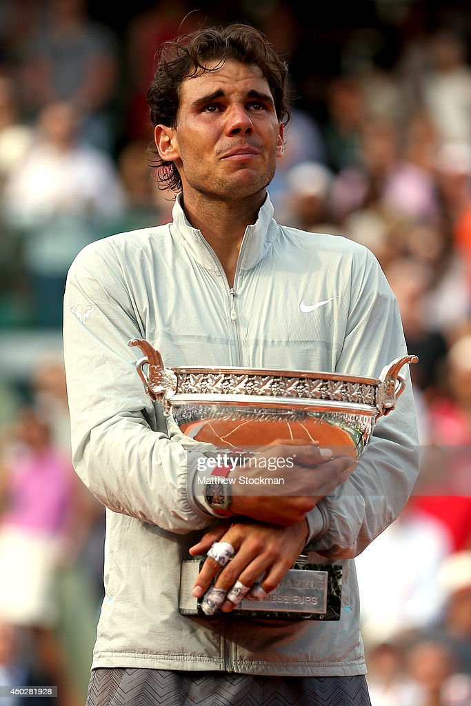 <a gi-track='captionPersonalityLinkClicked' href=/galleries/search?phrase=Rafael+Nadal&family=editorial&specificpeople=194996 ng-click='$event.stopPropagation()'>Rafael Nadal</a> of Spain celebrates with the Coupe de Mousquetaires after victory in his men's singles final match against Novak Djokovic of Serbia on day fifteen of the French Open at Roland Garros on June 8, 2014 in Paris, France.