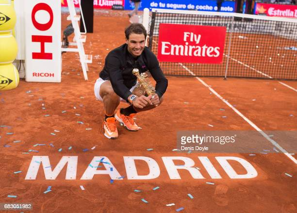 Rafael Nadal of Spain celebrates with the trophy after beating Dominic Thiem of Austria in the men's final at La Caja Magica on May 14 2017 in Madrid...