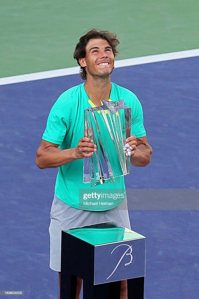Rafael Nadal of Spain celebrates with the trophy after defeating Juan Martin Del Potro of Argentina to win the men's final match of the 2013 BNP Paribas Open at the Indian Wells Tennis Garden on March 17, 2013 in Indian Wells, California.