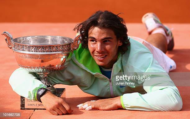 Rafael Nadal of Spain celebrates with the trophy after winning the men's singles final match between Rafael Nadal of Spain and Robin Soderling of...