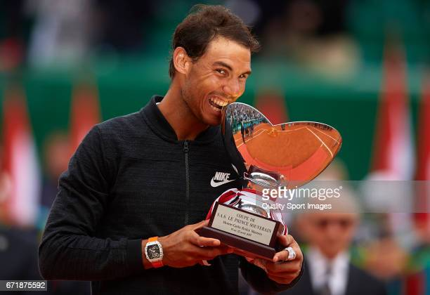 Rafael Nadal of Spain celebrates with the winner's trophy after defeating Albert RamosVinolas of Spain in the final during day eight of the ATP Monte...