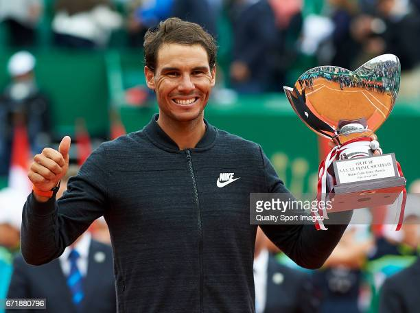 Rafael Nadal of Spain celebrates with the winners trophy after defeating Albert RamosVinolas of Spain in the final during day eight of the ATP Monte...