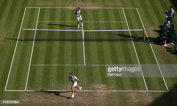 Rafael Nadal of Spain chases back to the baseline in his Gentlemens Singles Second Round match against Dustin Brown of Germany during day four of the...