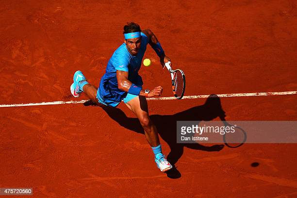 Rafael Nadal of Spain chases the shot in his Men's quarter final match against Novak Djokovic of Serbia on day eleven of the 2015 French Open at...
