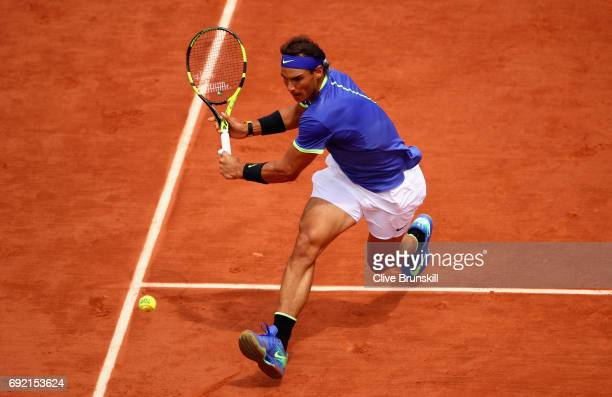 Rafael Nadal of Spain comes to the net to stretch for a plays a backhand during the mens singles fourth round match against Roberto Bautista Agut of...