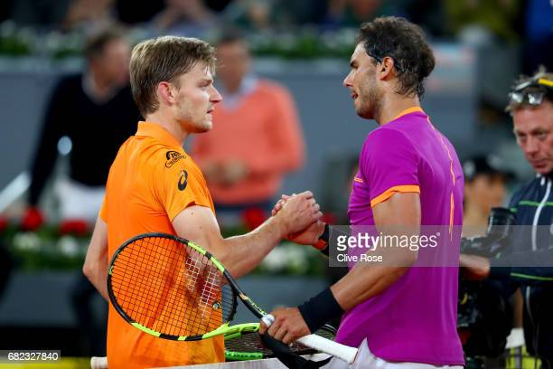 Rafael Nadal of Spain congratulates David Goffin of Belguim at the net after winning during day six of the Mutua Madrid Open tennis at La Caja Magica...