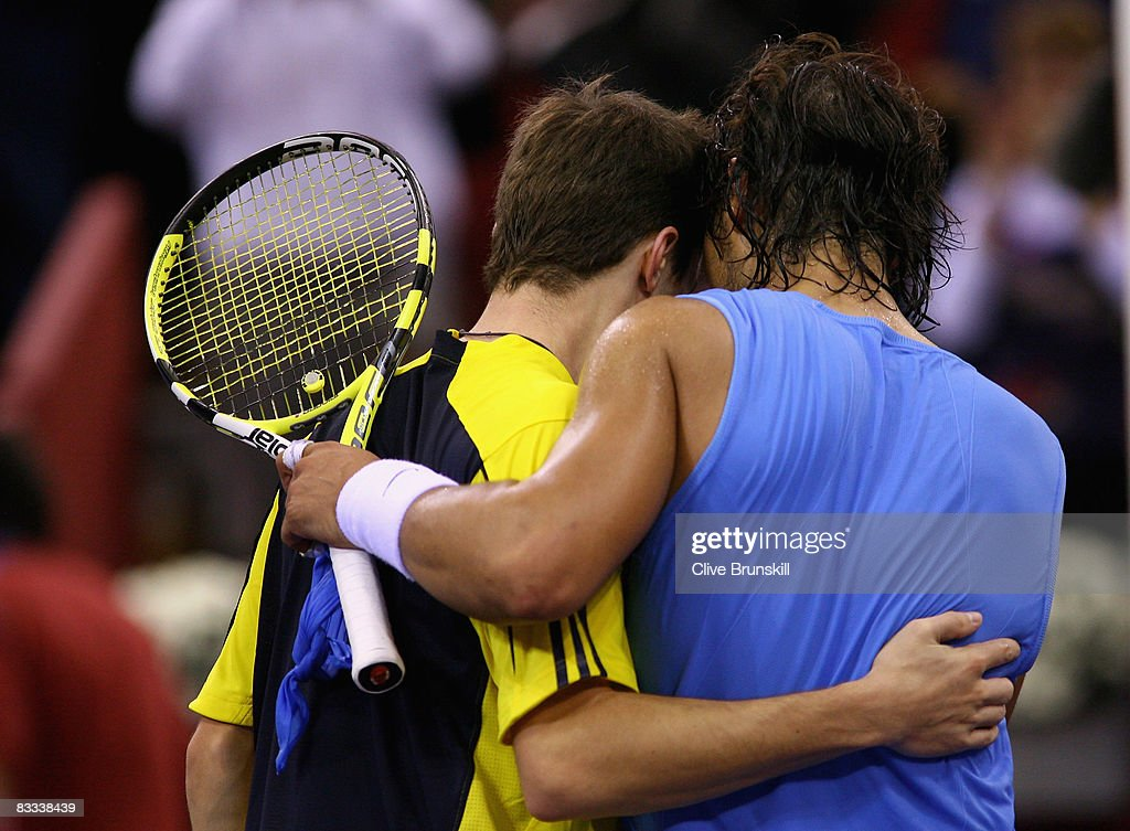 Rafael Nadal of Spain congratulates Gilles Simon of France at the net after Simon's three set victory in their semi final match at the Madrid Masters tennis tournament at the Madrid Arena on October 18, 2008 in Madrid, Spain.