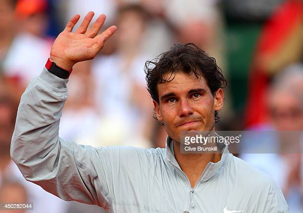 Rafael Nadal of Spain cries as he celebrates after his victory in his men's singles final match against Novak Djokovic of Serbia on day fifteen of...