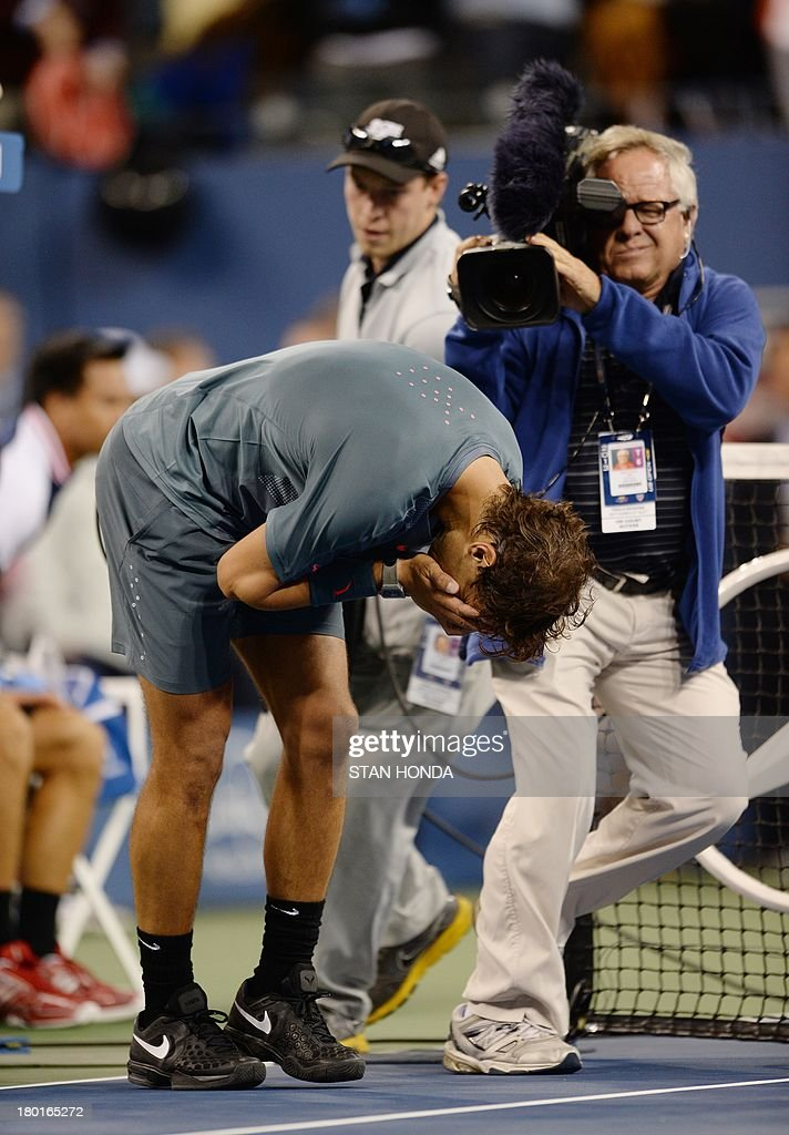 Rafael Nadal of Spain cries as he celebrates his win over Novak Djokovic of Serbia during their 2013 US Open men's singles final match at the USTA Billie Jean King National Tennis Center September 9, 2013 in New York. AFP PHOTO/Stan HONDA