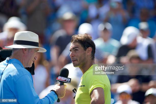 Rafael Nadal of Spain discusses his match with Brad Gilbert after winning the match during a match in the Western Southern Open at the Lindner Family...
