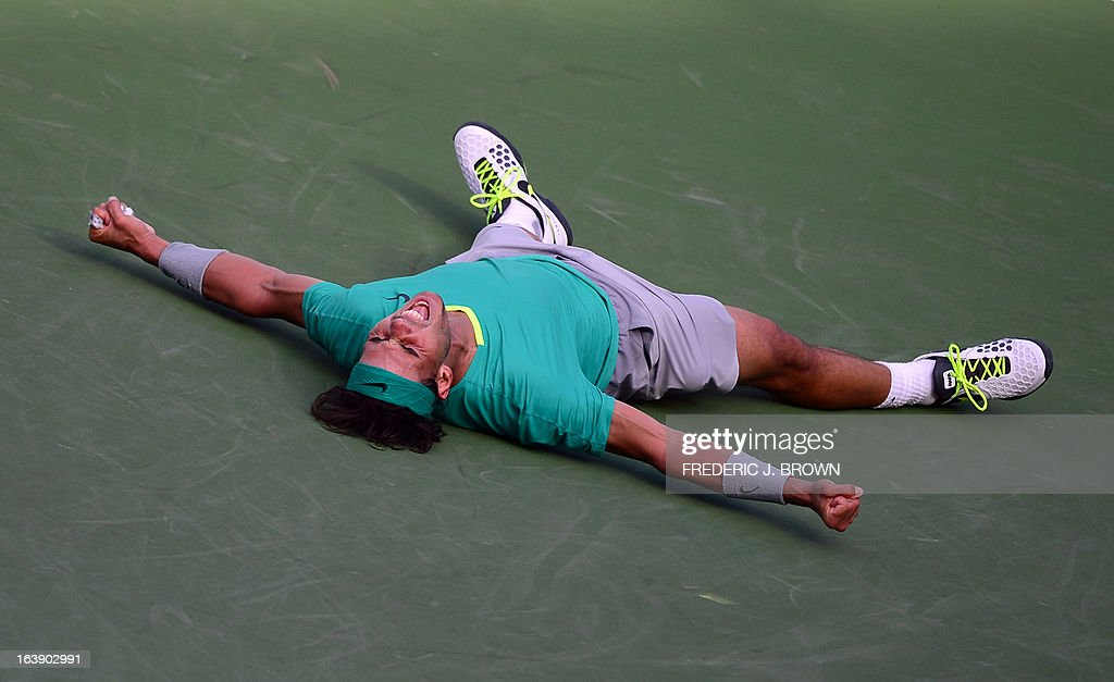 Rafael Nadal of Spain drops to the ground and shouts after defeating Juan Martin Del Potro of Argentina in three-sets on March 17, 2013 in Indian Wells, California, in the men's tennis final at the BNP Paribas Open. AFP PHOTO/Frederic J. BROWN