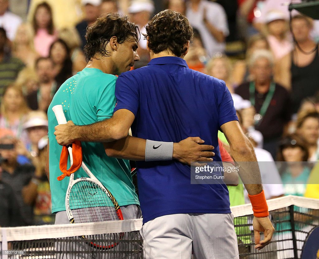 <a gi-track='captionPersonalityLinkClicked' href=/galleries/search?phrase=Rafael+Nadal&family=editorial&specificpeople=194996 ng-click='$event.stopPropagation()'>Rafael Nadal</a> of Spain (L) embraces with <a gi-track='captionPersonalityLinkClicked' href=/galleries/search?phrase=Roger+Federer&family=editorial&specificpeople=157480 ng-click='$event.stopPropagation()'>Roger Federer</a> of Switzerland after Nadal won their quarterfinal match during day 9 of the BNP Paribas Open at Indian Wells Tennis Garden on March 14, 2013 in Indian Wells, California. Nadal won 6-4, 6-2.
