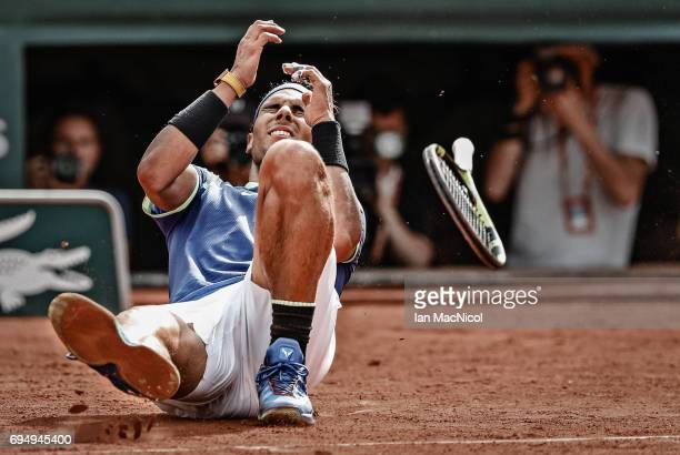 Rafael Nadal of Spain falls backwards after victory during his match against Stan Wawrinka of Switzerland during the Men's Singles Final on day...