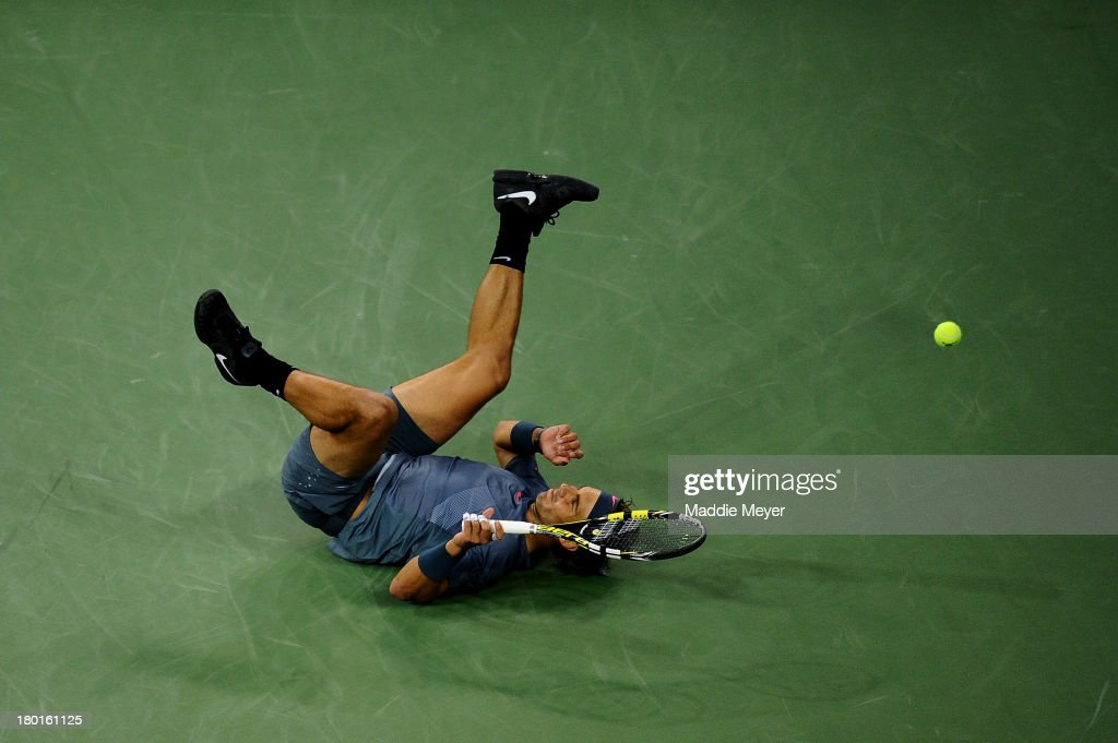 <a gi-track='captionPersonalityLinkClicked' href=/galleries/search?phrase=Rafael+Nadal&family=editorial&specificpeople=194996 ng-click='$event.stopPropagation()'>Rafael Nadal</a> of Spain falls over during his men's singles final match against Novak Djokovic of Serbia on Day Fifteen of the 2013 US Open at the USTA Billie Jean King National Tennis Center on September 9, 2013 in the Flushing neighborhood of the Queens borough of New York City.