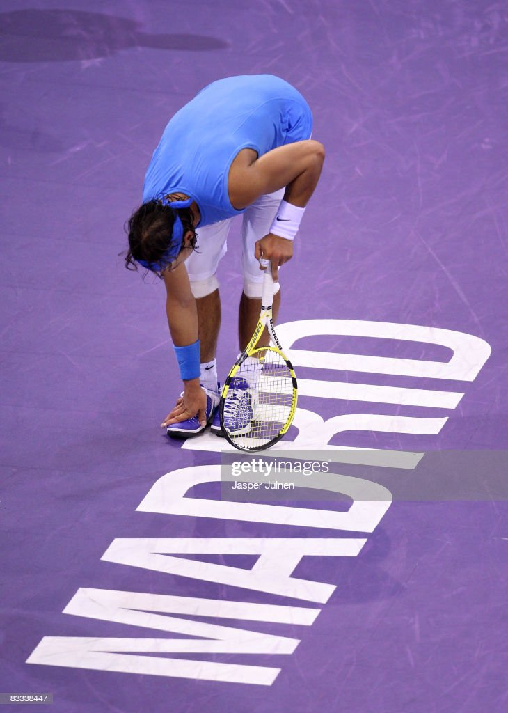 Rafael Nadal of Spain feels his foot during his semi final Madrid Masters tennis tournament match against Gilles Simon of France at the Madrid Arena on October 18, 2008 in Madrid, Spain. Nadal lost his match in three sets 6-3, 5-7 and 7-5.