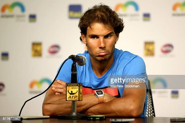 Rafael Nadal of Spain fields questions from the media after retiring from his match against Damir Dzumhur of Bosnia and Herzegovina after feeling...