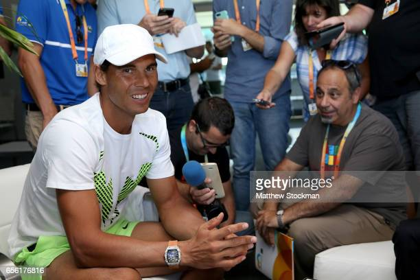 Rafael Nadal of Spain fields questions from the media at a player availability session during the Miami Open at the Crandon Park Tennis Center on...