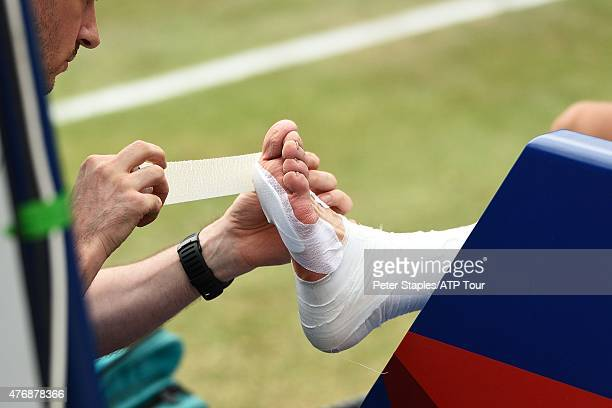 Rafael Nadal of Spain getting his blistered and battered foot bandaged during his win win against Bernard Tomic of Australia at the Mercedes Cup on...