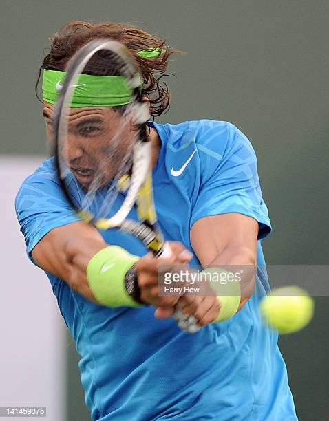 Rafael Nadal of Spain hits a backhand during a 46 75 64 win over David Nalbandian of Argentina at the Indian Wells Tennis Garden on March 16 2012 in...