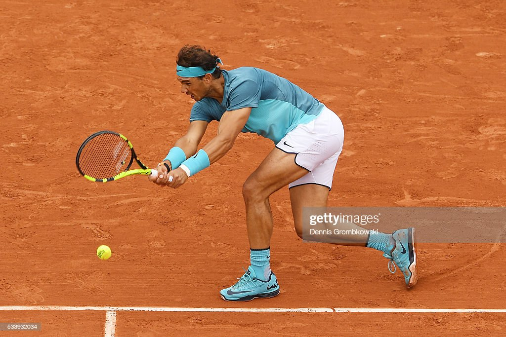 Rafael Nadal of Spain hits a backhand during the Men's Singles first round match against Sam Groth of Australia on day three of the 2016 French Open at Roland Garros on May 24, 2016 in Paris, France.