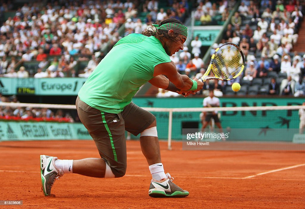 Rafael Nadal of Spain hits a backhand during the Men's Singles fourth round match against Fernando Verdasco of Spain on day eight of the French Open...