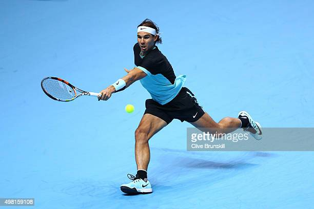 Rafael Nadal of Spain hits a backhand during the men's singles semi final against Novak Djokovic of Serbia on day seven of the Barclays ATP World...