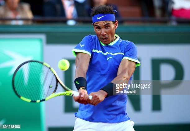 Rafael Nadal of Spain hits a backhand during the men's singles semi final match against Dominic Thiem of Austria on day thirteen of the 2017 French...