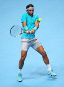 Rafael Nadal of Spain hits a backhand in his men's singles final match against Novak Djokovic of Serbia during day eight of the Barclays ATP World...