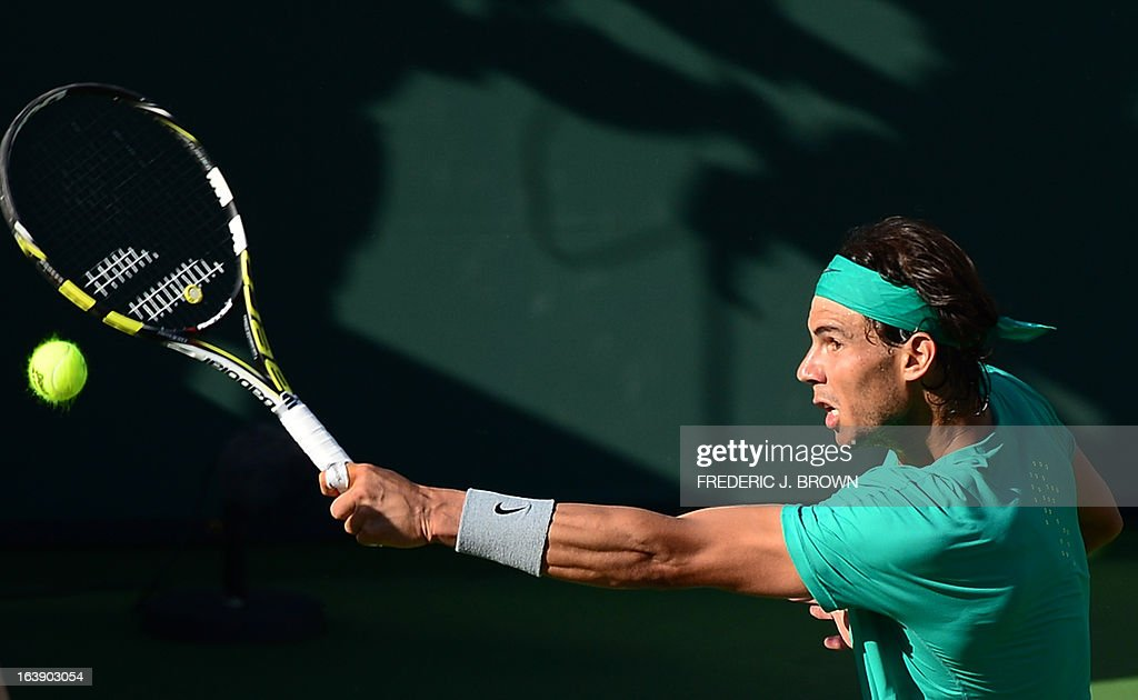 Rafael Nadal of Spain hits a backhand return against Juan Martin Del Potro of Argentina on March 17, 2013 in Indian Wells, California, in the men's tennis final at the BNP Paribas Open. AFP PHOTO/Frederic J. BROWN