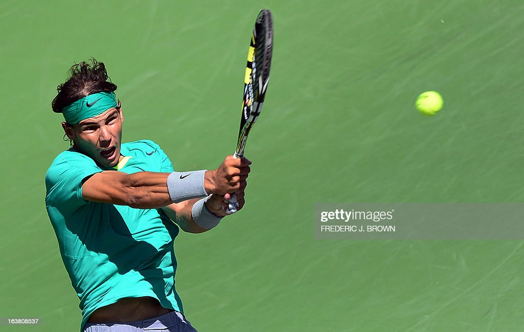 Rafael Nadal of Spain hits a backhand return to Tomas Berdych of the Czech Republic on March 16, 2013 in Indian Wells, California, in their semifinal match at the BNP Paribas Open which Nadal won. AFP PHOTO/Frederic J. BROWN